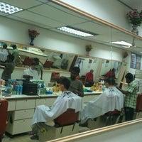 Photo taken at Kedai Gunting Rambut Bunga Raya by Mike C. on 4/16/2012