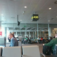 Photo taken at Gate A38 by Charlotte D. on 6/3/2012
