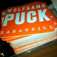 Photo taken at Wolfgang Puck Bar & Grill by Diana Bernal A. on 1/17/2012
