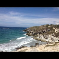 Photo taken at Playa Parguito by Efrain G. on 8/26/2012