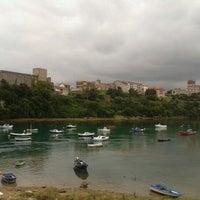 Photo taken at San Vicente de la Barquera by Antonio R. on 8/20/2012