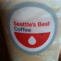 Photo taken at Lattetude Coffee Lounge & Bistro by Shea S. on 12/14/2011