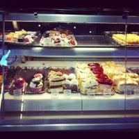 Photo taken at Aida Café-Konditorei by Teri K. on 8/12/2012