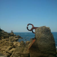 Photo taken at Peine del Viento by Luis C. on 8/9/2012