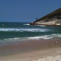 Photo taken at Praia de Grumari by Felipe V. on 9/29/2011