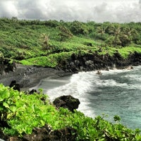 Photo taken at Black Sand Beach by Ashley S. on 7/3/2012
