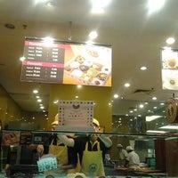 Photo taken at Big Apple Donuts & Coffee by Ella Zuriani M. on 3/13/2012