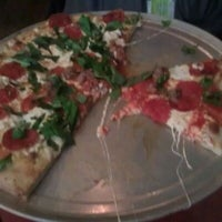 Photo taken at John's Pizzeria by James H. on 3/16/2012