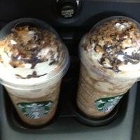 Photo taken at Starbucks by Jha on 7/23/2012