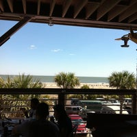 Photo taken at Fannies On The Beach by Angelia B. on 3/25/2012