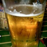Photo taken at Smugala's Pizza Pub by Kris K. on 3/11/2012