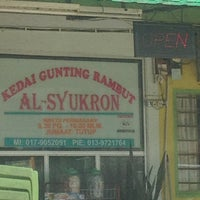 Photo taken at Kedai Gunting Rambut Al-Syukron by Fariza Z. on 2/15/2012