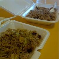 Photo taken at Jerkfish Jamaican Restaurant by Christopher B. on 6/28/2012