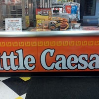 Photo taken at Little Caesars Pizza by Emily J. on 3/18/2012