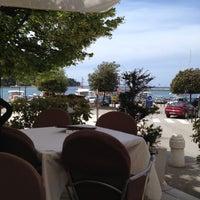 Photo taken at Rovinj Harbor by Alexander G. on 6/10/2012
