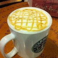 Photo taken at Starbucks by Wong V. on 3/14/2012