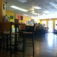 Photo taken at Mugs Coffee by Paris R. on 4/13/2012