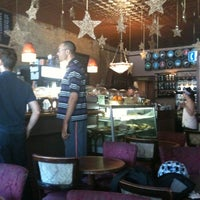 Photo taken at Tango Palace Coffee Company by Patrice L. on 6/23/2012