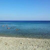 Photo taken at Feroe Beach by Antonis K. on 7/31/2012