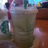 Photo taken at Starbucks by Sam O. on 7/25/2012