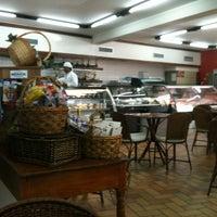 Photo taken at Palato Café by Giovani B. on 3/21/2012