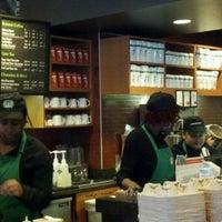 Photo taken at Starbucks by Liza S. on 3/20/2012