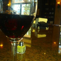 Photo taken at Toscana Cafe & Wine Bar by Bil A. on 8/8/2012