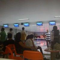 Photo taken at Strike Boliche Bar by Karla K. on 1/21/2012