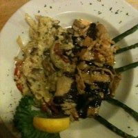 Foto tomada en Seasons & Regions Seafood Grill por Gretchen G. el 3/11/2011