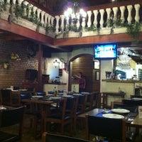 Photo taken at Faronella Ristorante e Pizzeria by Ricardo M. on 9/4/2011