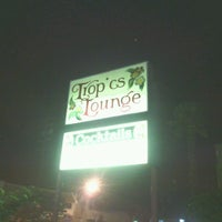 Photo taken at Tropics Lounge by Craig on 8/12/2012