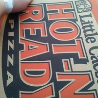 Photo taken at Little Caesars 2000 by Marie C. on 5/12/2012
