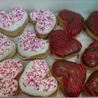Photo taken at Krispy Kreme Doughnuts by Audrey W. on 2/14/2012