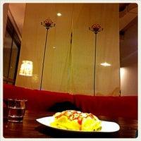 Photo taken at Momo Cafe by Nan X. on 5/13/2012