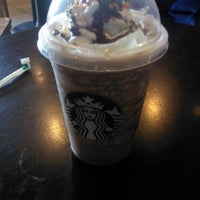 Photo taken at Starbucks by Emily C. on 7/6/2012