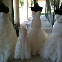 Photo taken at Ellynne Bridal Gallery by Madison G. on 9/9/2012