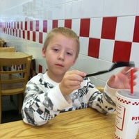 Photo taken at Five Guys by Kam S. on 3/13/2012