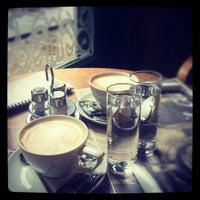 Photo taken at Le Petit Café by Valerija S. on 12/3/2011