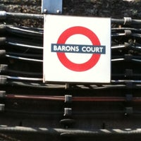 Photo taken at Barons Court London Underground Station by Alicia N. on 6/8/2011