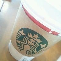 Photo taken at Starbucks by Lemi P. on 12/8/2011