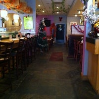 Photo taken at Empire Chinese & Japanese Cuisine by Nikos M. on 12/26/2010