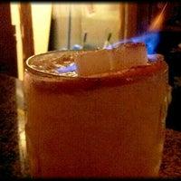 Photo taken at Bad Juju Tiki Bar by Kate M. on 9/9/2011