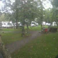 Photo taken at Ravenglass Camping and Caravanning Club by Catherine S. on 9/12/2011