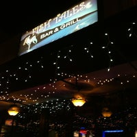 Photo taken at Fishtales On 33rd Bar & Grill by Carlos M. on 3/30/2012