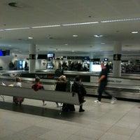 Photo taken at Baggage Reclaim by Nine V. on 10/23/2011
