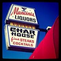 Photo taken at Mancini's Char House & Lounge by Nancy N. on 8/24/2011
