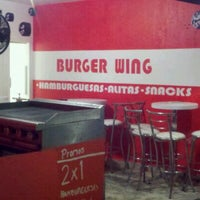 Photo taken at Burger Wing by Miguel R. on 5/1/2012