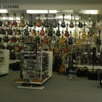 Photo taken at Guitars Etc by Mellissa E. on 8/28/2012
