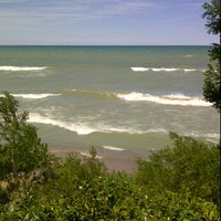 Photo taken at Forest Beach by Jodie S. on 8/11/2011