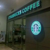 Photo taken at Starbucks by Cristian B. on 12/7/2011